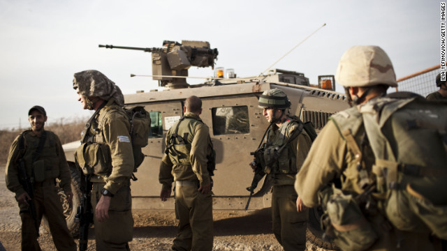 Israeli soldiers conduct a patrol as some 16,000 reserve troops are drafted in on Friday.
