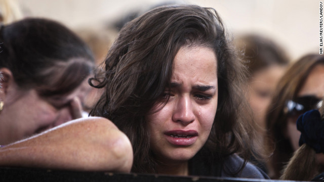 A woman cries during the funeral of Itzik Amsalam on Friday.