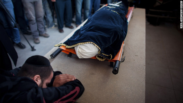 A relative grieves during the funeral for Itzik Amsalem in Kiryat Malakhi, Israel, on Friday.