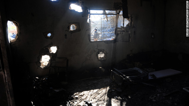 A picture shows a heavily damaged house after airstrikes by Syrian regime forces in Ras al-Ain on Friday.