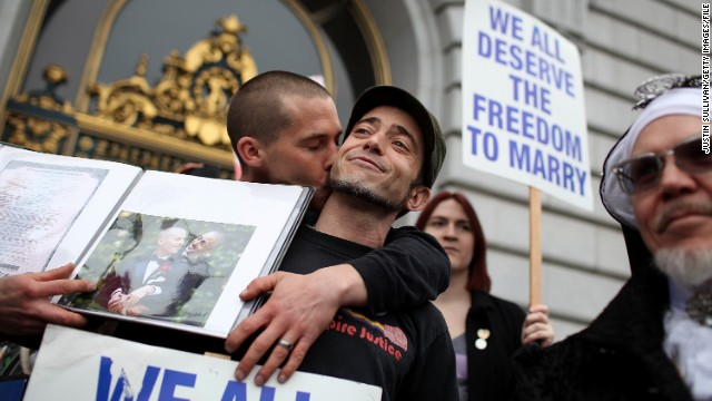Same-sex couple Frank Capley-Alfano (L) and Joe Capley-Alfano kiss at City Hall in San Francisco, California, on February 7.