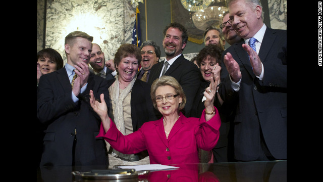 Washington Gov. Chris Gregoire celebrates after signing marriage equality legislation into law earlier this year. Voters there approved same-sex marriage on Election Day.
