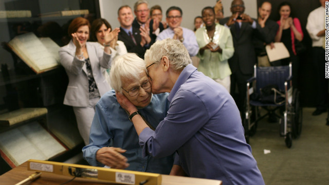 Phyllis Siegel, 76, right, kisses her wife, Connie Kopelov, 84, after exchanging vows at the Manhattan City Clerk's office with New York City Council Speaker Christine C. Quinn in attendance on July 24, 2011, the first day New York state's Marriage Equality Act went into effect.