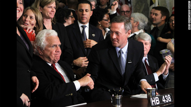 Maryland Gov. Martin O'Malley, center, shakes hands with Senate President Thomas V. Mike Miller after signing a same-sex marriage bill. The law was challenged, but voters approved marriage equality in a November 2012 referendum.