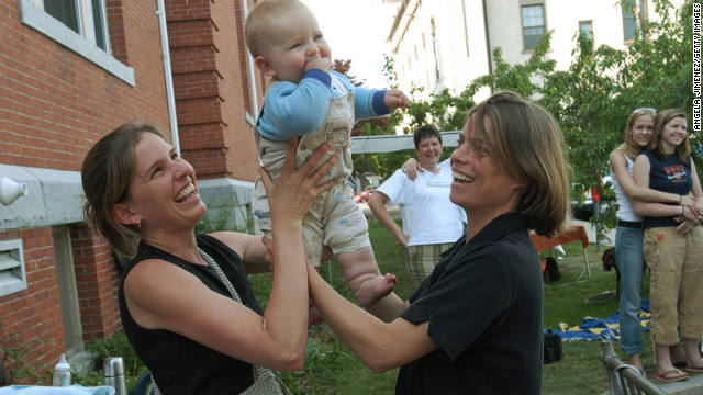 Lara Ramsey, left, and her partner of eight years, Jane Lohmann, play with their 7-month-old son, Wyatt Ramsey-Lohmann. The two wed in 2004 after Massachusetts approved same-sex marriage. Massachusetts was the first state to do so.