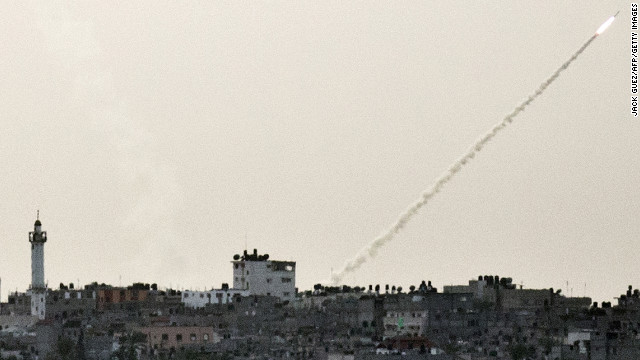 A rocket fired from Gaza toward Israel sails into the air Friday.