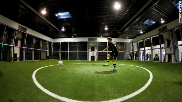 The &quot;Footbonaut&quot; -- is a robotic cage which footballers can use to improve passing, spatial awareness and control. The machine is being used by German champions Borussia Dortmund.
