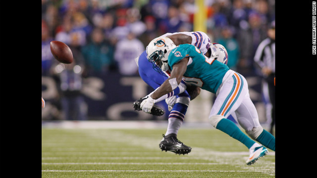 Miami's Reshad Jones, right, knocks the ball free from Donald Jones of the Buffalo Bills.