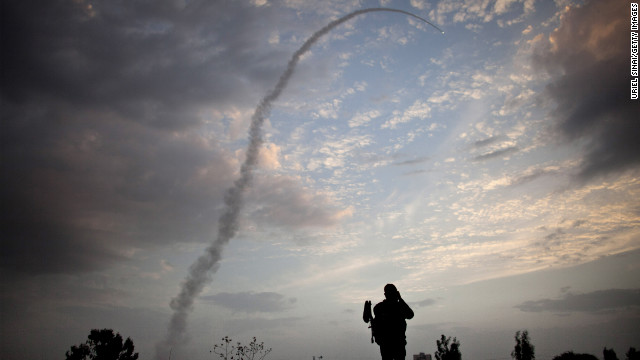 An Israeli missile from the Iron Dome defense missile system is launched to intercept and destroy incoming rocket fire from Gaza on November 17 in Tel Aviv, Israel. Israeli troops have been massing on the border as some 200 targets were hit overnight in Gaza, including Hamas cabinet buildings.