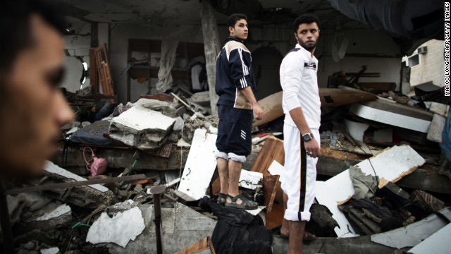 Palestinians stand on the rubble of the demolished home of Ezzedine Haddad, commander of the armed wing of the Hamas movement, the Ezzedine al-Qassam Brigades, that was destroyed by an Israeli airstrike in Gaza City on Saturday. Israeli air strikes in Gaza killed 10 Palestinians, five of them militants, as nine Israelis were hurt by rocket fire, four of them soldiers, medics said.