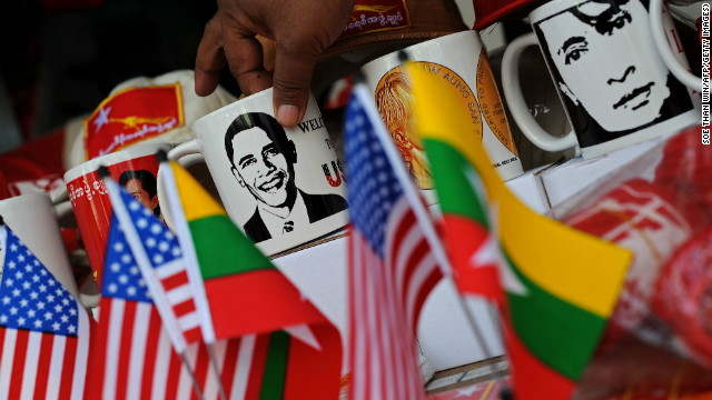 Cups printed with pictures of US President Barack Obama and Myanmar opposition leader Aung San Suu Kyi are displayed at a shop in downtown Yangon on Saturday.
