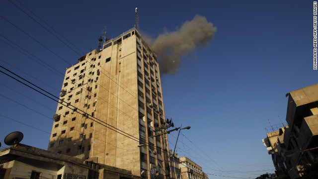 Smoke rises after an Israeli air strike on an office of Hamas television channel Al-Aqsa in the southern Gaza town of Rafah on Sunday. Israeli warplanes hit the Gaza City media center and homes in northern Gaza in the early morning.