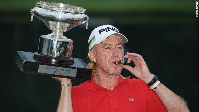 Miguel Angel Jimenez celebrates his victory in Hong Kong in familiar fashion, with a cigar and a glass of red wine