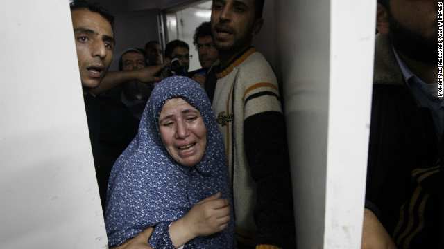 Palestinian relatives grieve at the hospital in Gaza City on Sunday over family members killed in an airstrike.