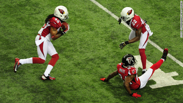 Rashad Johnson of the Cardinals intercepts a pass intended for Roddy White of the Falcons on Sunday.
