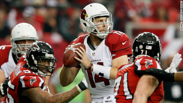 Ryan Lindley of the Cardinals looks to pass against the Falcons before fumbling the ball from pressure by John Abraham and Kroy Biermann at Georgia Dome on Sunday.