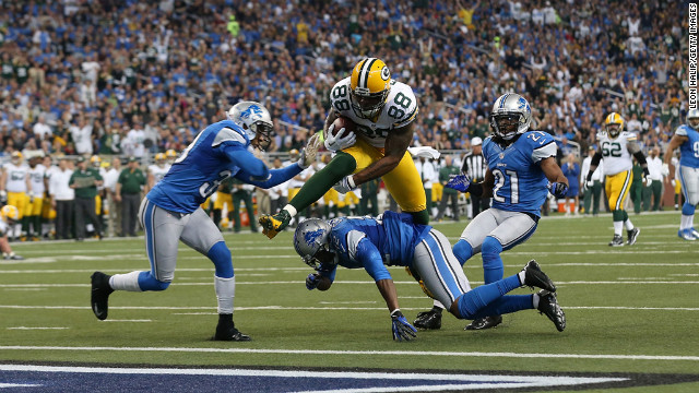Jermichael Finley of the Green Bay Packers scores on a 20-yard pass from Aaron Rodgers during the second quarter of the game against the Lions on Sunday.