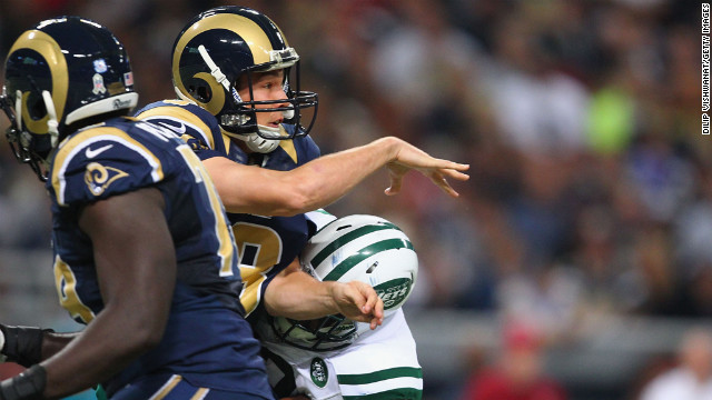 Sam Bradford of the St. Louis Rams is hit after passing the ball against the New York Jets at the Edward Jones Dome on Sunday in St. Louis.