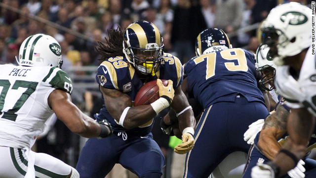 Running back Steven Jackson of the Rams runs up the middle during the game against the Jets on Sunday.