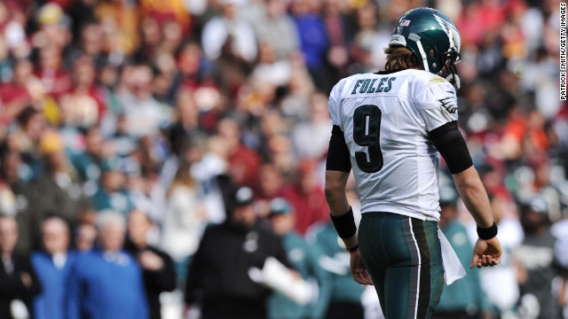 Quarterback Nick Foles of the Eagles walks off the field after an incomplete pass against the Redskins in the first quarter on Sunday.