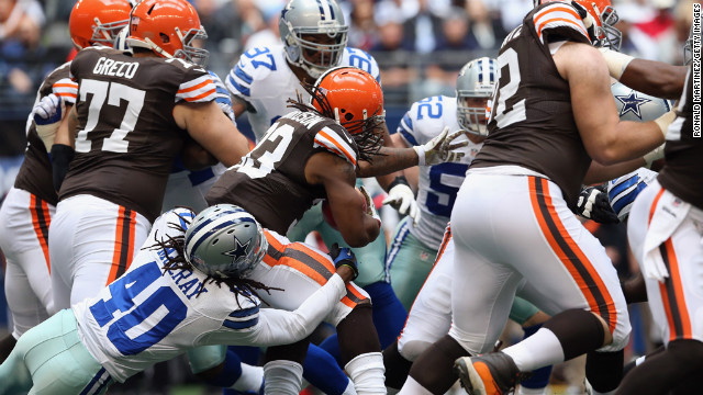 Trent Richardson of the Browns runs the ball against Danny McCray of the Cowboys on Sunday.