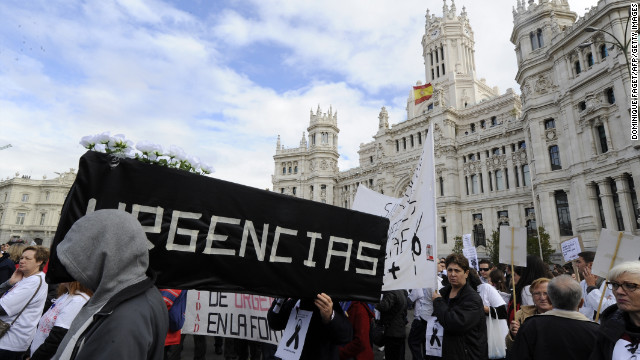 Medical workers demonstrate in Madrid against the Spanish government's latest austerity measures to deal with Spain's crippling debt.
