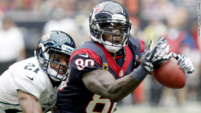 Andre Johnson of the Houston Texans can't quite make the catch while Derek Cox of the Jacksonville Jaguars defends on Sunday at Reliant Stadium in Houston. 