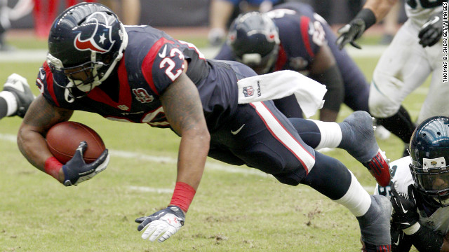 Arian Foster of the Texans rushes against the Jaguars on Sunday.