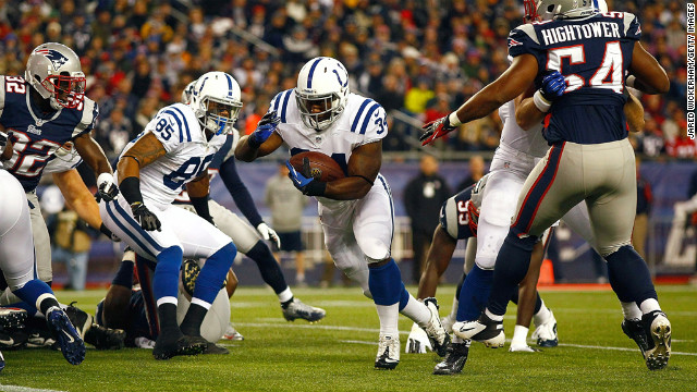 Delone Carter of the Colts runs in for a touchdown on their first drive in the first quarter against the Patriots on Sunday.