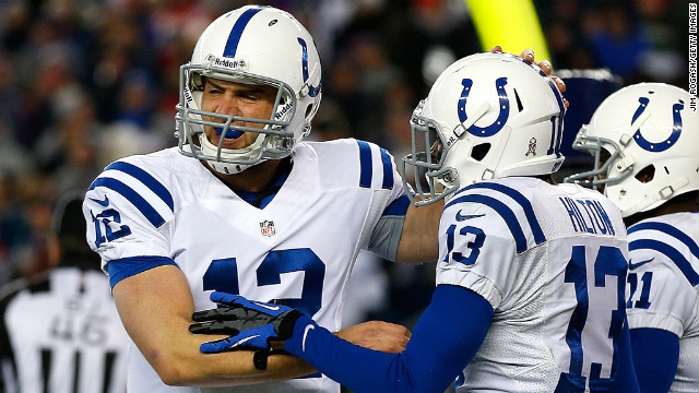 T.Y. Hilton of the Colts celebrates his touchdown with No. 12 Andrew Luck and No. 11 Donnie Avery in the first half against the Patriots on Sunday.