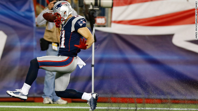 Julian Edelman of the Patriots celebrates after returning a punt for a touchdown against the Colts in the first half on Sunday.