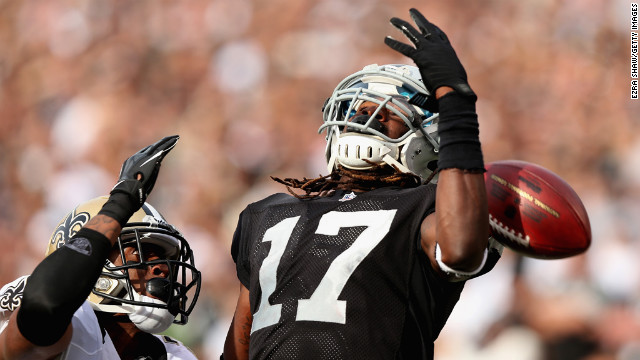 Denarius Moore of the Raiders cannot catch a pass while defended by Patrick Robinson of the Saints on Sunday.