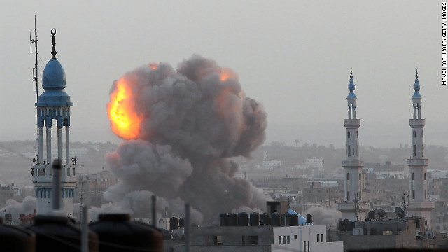 A fireball rises as the Israeli air force carries out a raid over Gaza City on Saturday, November 17.