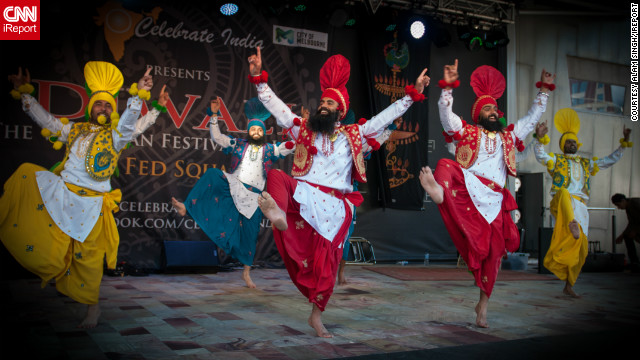 "<a href='http://ireport.cnn.com/docs/DOC-881415' target='_blank'>Alam Singh</a> captured this cool image of Diwali celebrations in downtown Melbourne, Australia. ""There were many dance performances by local and foreign talent, and of course the 8000 plus people in the crowd dancing too,"" he says."