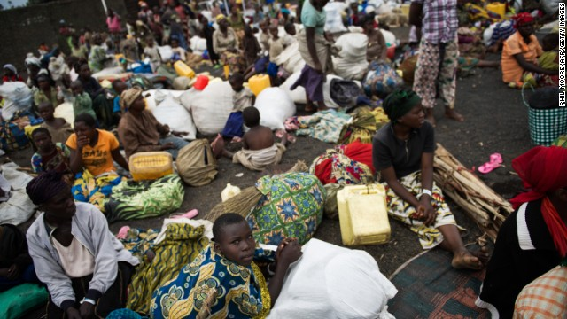 Displaced Congolese sit inside a United Nations base in Monigi, 5km from Goma, as they seek shelter after being forced to flee a temporary camp, on November 18, 2012.