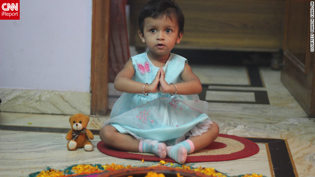 """This is my daughter Kyra doing Goddess Luxmi worship,"" says avid iReporter <a href='http://ireport.cnn.com/docs/DOC-881017' target='_blank'>Manish Kanojia</a> from New Delhi. According to her dad, Kyra thoroughly enjoyed her first ever festival of lights although ""she was slightly scared of the Diwali crackers."""