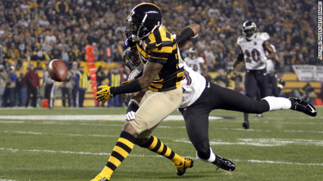 Chykie Brown of the Baltimore Ravens is called for pass interference against Mike Wallace of the Pittsburgh Steelers during Sunday night's game.