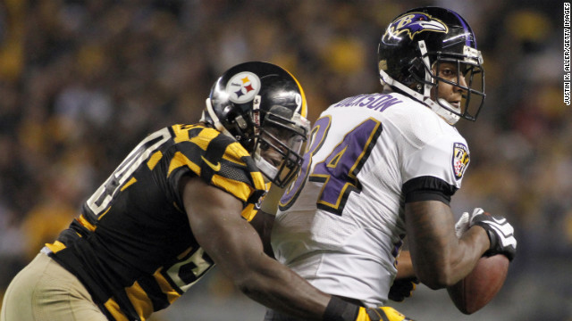 Ed Dickson of the Baltimore Ravens makes a catch against Lawrence Timmons of the Pittsburgh Steelers.