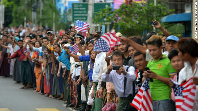 Local residents wait in anticipation as Obama's motorcade drives to the Parliament House in Yangon.
