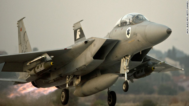 An Israeli F-15 takes off from an Israeli air force base on Monday, November 19, on a mission over the Gaza Strip. Israel carried out 80 strikes on Monday, raising to more than 1,300 the number of sites targeted since it began its bombing campaign on Wednesday, according to the Israel Defense Forces.
