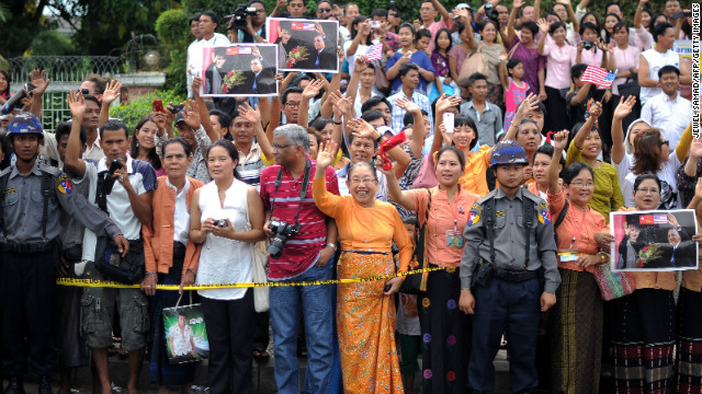 Local residents gather outside Aung San Suu Kyi's house as U.S. President Obama met with her on Monday. 