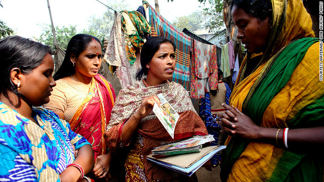 Shamola Rani Mondol (center) in Dhaka, Bangladesh, is a local WASH committee member. All nine members of the committee are women who teach others in the community about hygiene. She says: &quot;The men respect us more now. Nowadays when we go anywhere the men give us seats with honor and they say that the women are able to do lots of things. Now the men are happy with the women's work.&quot;