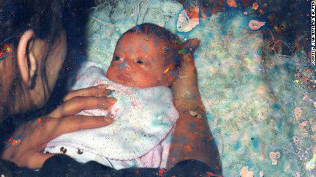 Someone cradles a baby in a snapshot found after Superstorm Sandy destroyed several homes in Union Beach.