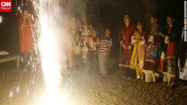 "<a href='http://ireport.cnn.com/docs/DOC-882277' target='_blank'>Syed Yasir Kazmi</a> captured this photo of Diwali celebrations in Karachi, Pakistan. ""Everyone was happy, distributing sweets, doing prayer of Lukshmi Devi, and enjoying fireworks,"" he says. ""What was most special to me was the happiness and joy on everyone's faces."""