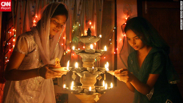 "New Delhi based student, Tazeen Qureshy, snapped this image whilst visiting her home-town of Bhubaneswar, eastern India during Diwali. ""For me, Diwali is a festival to enjoy with family and friends and most importantly it illumines lives with new energy and hope,"" she says."