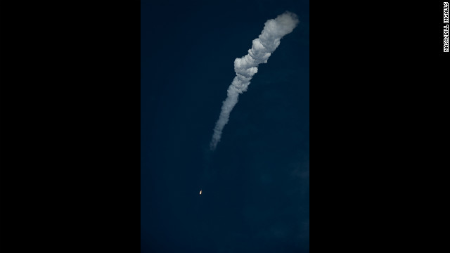 The Soyuz rocket shoots through the atmosphere on Tuesday with the new crew. 