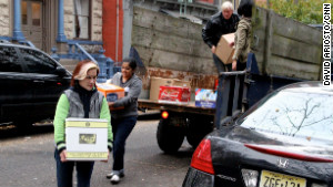 Volunteers carry supplies to a grass-roots relief hub for Superstorm Sandy\'s victims in Jersey City, New Jersey.