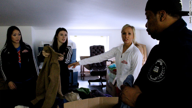 Even the U.S. women's Olympic gymnastics team heard about the effort and decided to help. Here, they hand out clothing to storm victims.