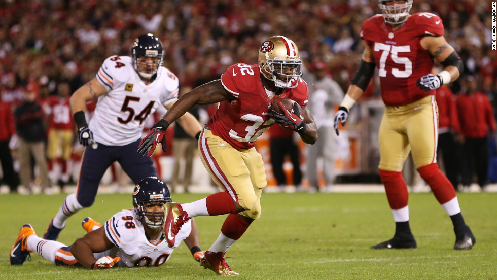 Kendall Hunter of the San Francisco 49ers breaks away from Chicago Bears defenders for a second quarter touchdown on Monday, November 19, at Candlestick Park in San Francisco. Check out the action from Week 11 of the NFL and &lt;a href='http://www.cnn.com/2012/11/08/football/gallery/nfl-week-10/index.html'&gt;look back at the best photos from Week 10&lt;/a&gt;.