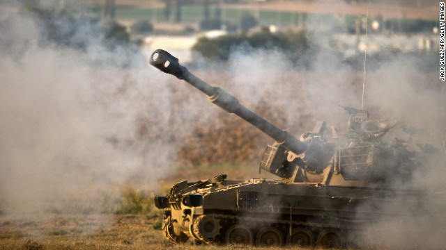 Israeli forces fire a shell from the Israel-Gaza border into Gaza on Tuesday.